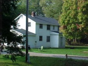 12.8 ACRES. 2 duplexes and 1 single family . Gross income of 26000/year (photo 1)