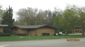 Office building with 1/2 of building with tenant.   Call agent for more information.  Full basement. (photo 1)