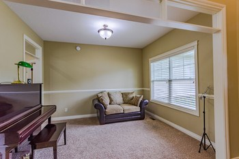 Style and Function. The formal dining room is to the right of the foyer and flows easily into the kitchen and casual dining area. Currently used as a music room, the space would also make a wonderful main floor office! (photo 3)