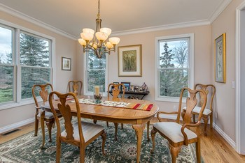 Wood floors in this charming dining room (photo 4)