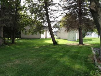 The lot is 217 feet deep and has plenty of space to move about.  There are lots of mature trees for shade. (photo 4)