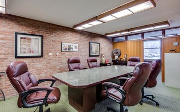 Fantastic conference room is connected to an office in front and just off the reception area. (photo 5)