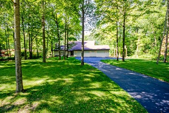 The home is peacefully set back on the lot adding privacy and beautiful wooded views from every window in the home. (photo 3)