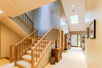 Dramatic architectural lines greet you in the entryway and carry throughout the main living spaces. (photo 4)