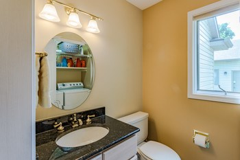 This bright and cheery half-bath sits just off the entry and has the same beautiful granite countertops as the kitchen. (photo 5)
