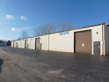 21,000 square feet of industrial space located just south of the four way access to Business 10 at Waldo Road, in Midland, MI.  Built in 1996 and has easy and close access to Dow Chemical and anything Tri-Cities. The main building is approximately 19,200 square feet and the auxiliary building is 1,800 square feet.   Some features of the main building include five fourteen foot overhead doors, 5 bathrooms, 5 bays, some office space... (photo 1)