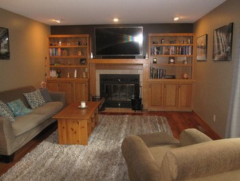The family room has custom built ins, fireplace and wood floors that is open to the kitchen. (photo 4)