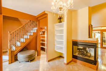 Large elegant foyer, stairs lead to 4th bedroom and bath.  The foyer is so large you could easily add a couple chairs for an additional sitting area. (photo 4)