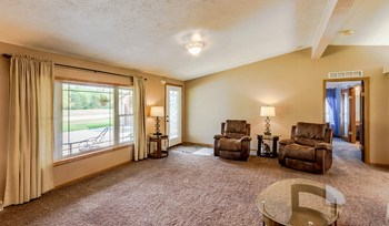 Nice living room with large newer windows (photo 3)