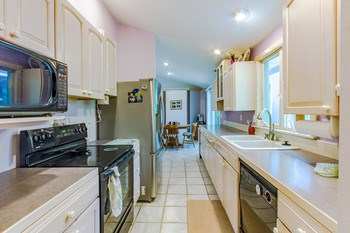 Cooking in this kitchen is a joy with an abundance of cabinetry and counter space. Ceramic tiled floors extend into the eating area. (photo 3)