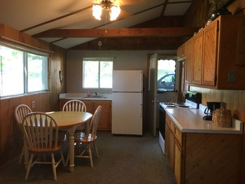 Kitchen with appliances that are staying. (photo 3)