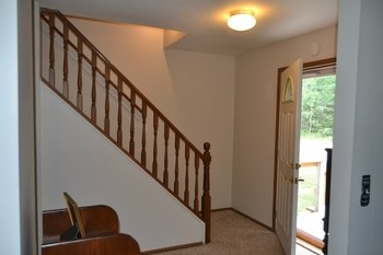 Once inside the front entry gives you plenty of space for welcoming guest.  There is a large coat closet, open staircase to the second floor and the area is open to the Living room. (photo 4)