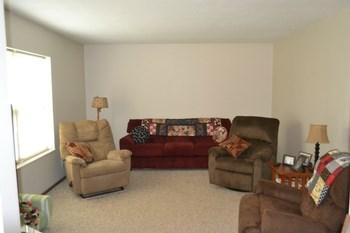 The living room is a good size.  Just recently completed is the fresh paint and new carpeting. The room has a large picture window that looks out over the front yard and allows plenty of natural light into the room. (photo 5)