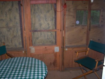 This is the screened eating area of the cook house. Currently with tarps down on the windows. (photo 5)