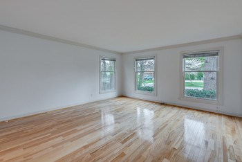The Living Room is very good sized... has very attractive crown molding and how can you miss the beautiful wood floors. (photo 4)