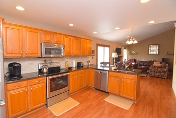 Cook while enjoying your company with this open floor plan.  Kitchen and family room are one. (photo 3)
