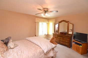 Large master bedroom with an abundant amount of natural light. (photo 5)