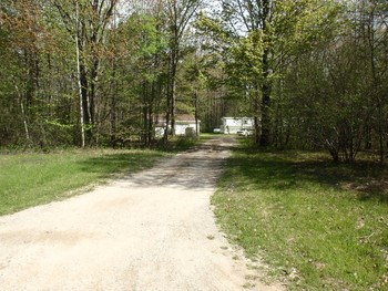 30 Wooded Acres! Beautiful Building Site in Greendale Township. There is a Mobile Home & 3 Car Garage on the Property Along with the Well & Septic. Mobile Home is of Little Value but is Livable While Your Building Your Dream Home!  Seller will Have the Property Surveyed for the exact Dimensions & Legal Description. Bullock Creek Schools. (photo 1)