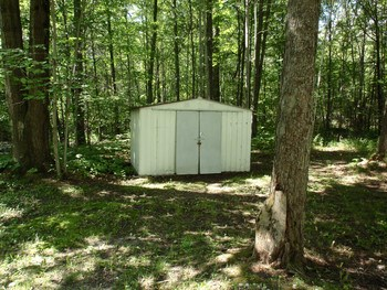 Small storage shed is included. (photo 5)