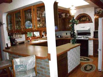 View of the Kitchen from the front door, Formica was redone approx. 2-3 yrs ago.  Laminate  flooring was also added. All kitchen appliances stay. (photo 3)