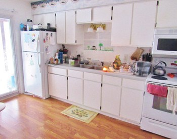Dine in kitchen with lots of cabinet space. (photo 2)