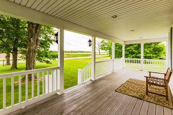 Perfect for late summer evenings or crisp autumn mornings, dream your life away on the front porch with views of open pastures for miles. (photo 4)