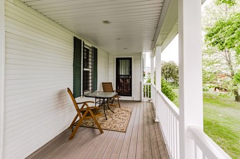 Composite decking on the front porch means virtually no maintenance, just sit back and relax. (photo 5)