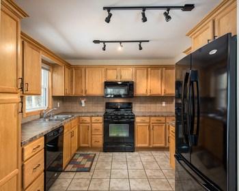 Newer kitchen with heated ceramic floors. (photo 3)