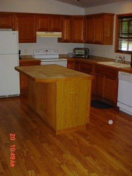 The Kitchen has a island with a ceramic Tile top in the Great Room (photo 3)