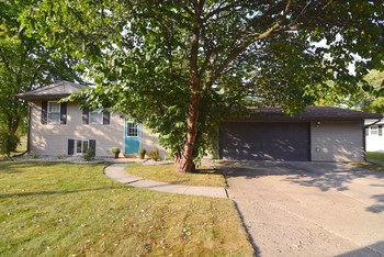 This beautifully updated 4 bedroom home in Thomas Twp has so much to offer.  New roof and septic in 2014 and newer furnace and A/C are only some of the recent improvements.  Home boasts a large deck off the dining room, an over sized 2.5 car garage and city water. (photo 1)