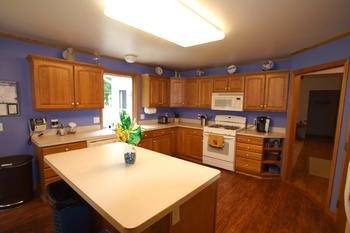 The kitchen work space has plenty of space to move about.  The chef in the family can spread out with the ample counter space and island area.  The window over the sink looks out to the backyard.  The kitchen is off to one side of the great room so it is hidden from guest. (photo 5)