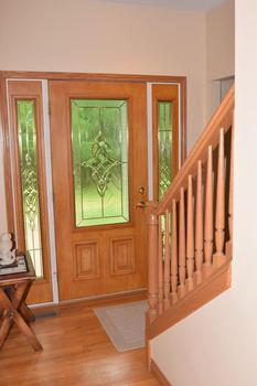 Inside the front door entryway is the staircase leading to the bedrooms. to the left upon entry is the living room and the hallway leads to the kitchen. (photo 4)