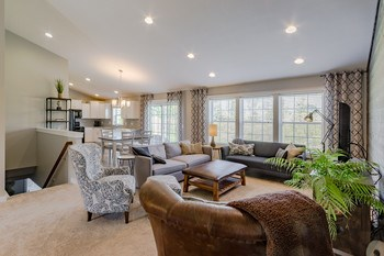 The feeling of a casual elegant lifestyle is prevalent as soon as you enter the home. You and your guests will be taken back by the beautiful wood feature wall, and the custom fixtures & finishes throughout the open floor plan. Move right into a homes magazine! All you have to do is add your own memories. (photo 2)