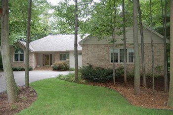 Welcome Home to this beautiful ranch style home with 4 bedrooms and 3 full baths.  The home is all brick with a terrific sun room 13 x 12with lots of windows.  New Roof and garage door in 2006 and a gas log fireplace. (photo 1)