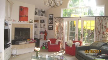 Living room with fire place and large patio doors (photo 2)