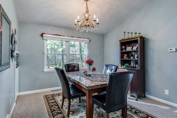 Formal dining room with pass through to the kitchen. (photo 3)