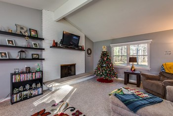 Spacious living room with one of two cozy fireplaces. (photo 5)