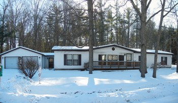 Terrific ranch with 2 1/2 car attached garage and private back yard!   Large workshop, updated kitchen counters and bathrooms, large living and family rooms, deck, newer furnace and hot water heater.   Great location close to US 10.  Water access to Sanford Lake!  Come check it out today! (photo 1)