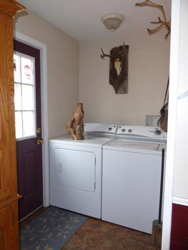 The laundry area is at the back door. (photo 4)