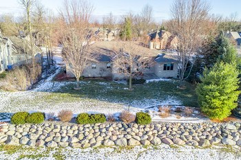 Aerial view of boulder wall and manicured lawn (photo 5)