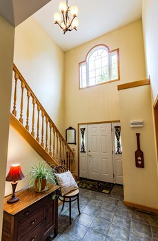 This entryway is designed to impress with it's high ceilings, second story window and view to the great room. (photo 3)