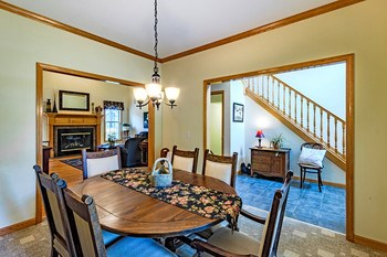 Just off the front entry of the home, you will notice the formal dining room. Spacious enough for a large holiday gathering, yet open and bright for a comfortable and casual everyday lifestyle. (photo 4)