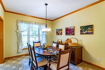 This formal dining room just off the entry offers space to entertain, or could easily be transformed into an office or extra living space to fit your lifestyle. (photo 5)