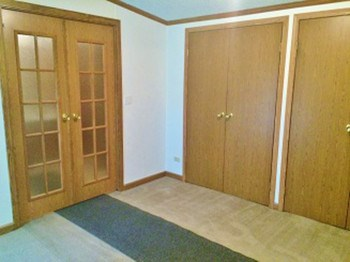The master bedroom has double closets and through the French doors is a wonderful master bathroom. (photo 4)