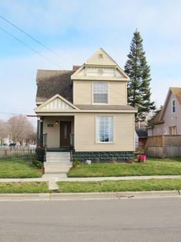 This three bedroom two bath home has plenty of space to spread out and yet cozy. The character and charm overflows inside this home. (photo 2)