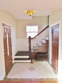 The foyer with tiled floors, original wood closet door and the original banister with so much detail work will welcome friends and family! (photo 3)