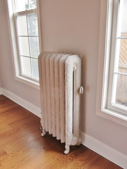 The design on the radiators is intricate and detailed. There's charm everywhere. (photo 5)