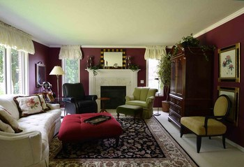 The formal living room gives a great first impression with its elegant fireplace. (photo 4)