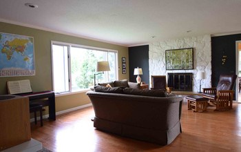 The family room is open to the kitchen and dining area and includes a gas fireplace.  Hardwood floors are in perfect condition. (photo 4)