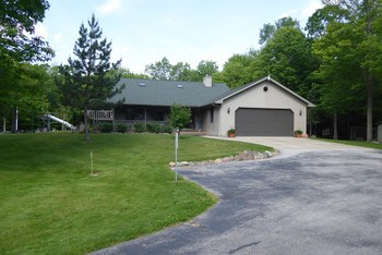 Welcome to a little piece of heaven on earth, in this meticulously well thought out open floor plan, 4 bedroom, 2.5 bath home that features 2'x6' construction, Anderson windows, and new roof in 2010. Every detail has been planned out to make this a truly delightful home that you'll love to call your own.   This property includes 10.1 acres, plus up to 30 additional acres can be purchased, and has access to state land, the rail trail, a perimeter trail around the property with corner survey markers, up to 140 yard shooting range, 25' deep pond with aerator, All hardwood floors and trim are Amish milled from trees on the property.  Access to US-10 is 2.5 miles away and the City of Midland is a short 15 minute drive.  School of choice between Meridian and Coleman School districts. (photo 1)